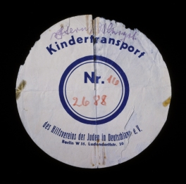 Circular label from the suitcase used by Margot Stern when she was sent on a Kindertransport to England. Germany, December 1938. Source: US Holocaust Memorial Museum